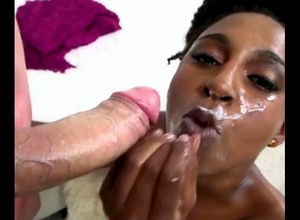 Curly ebony fuckslut gets heavy facial..