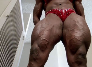 Black lady bodybuilder in crimson..